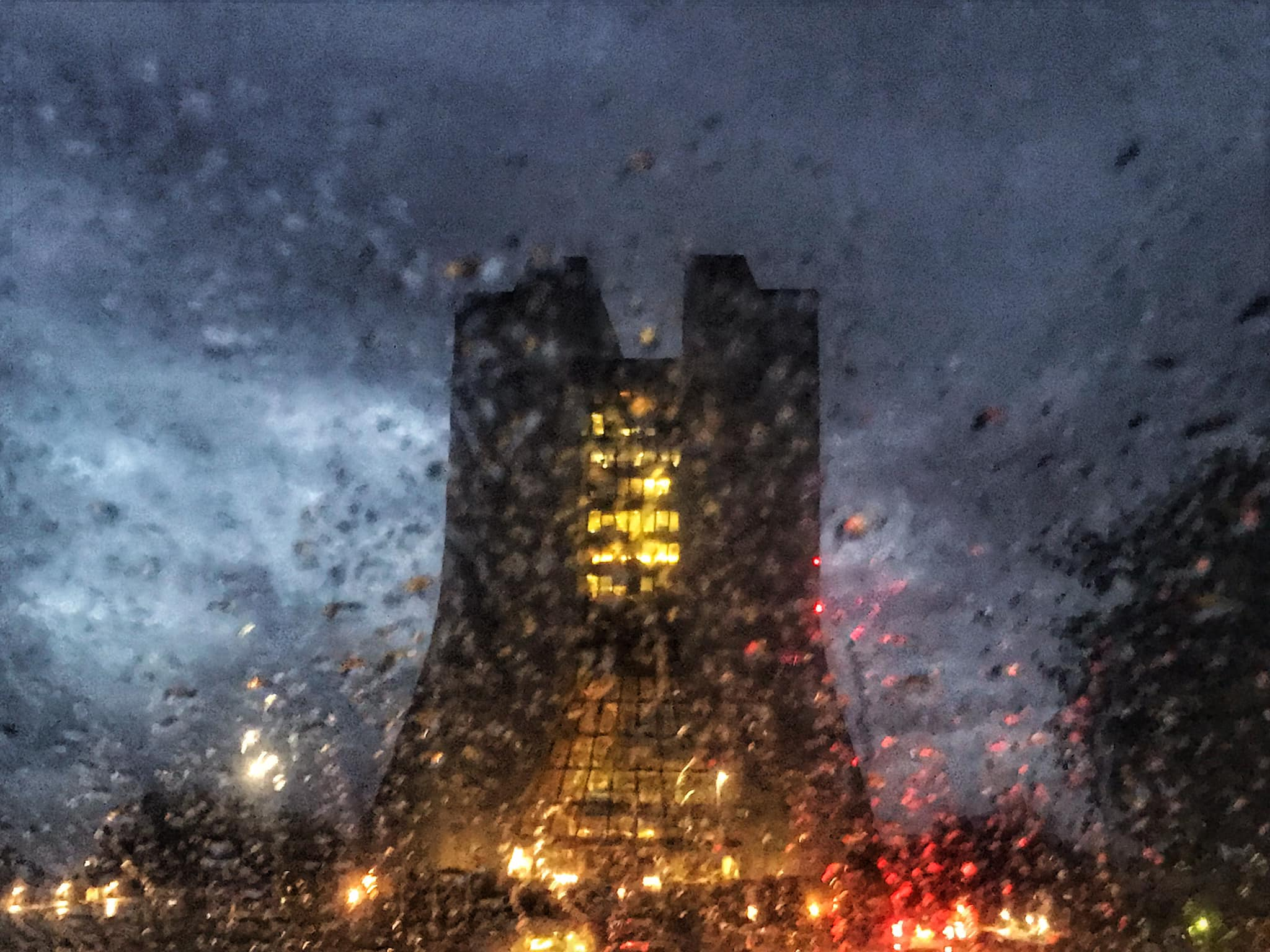 (4/4) And this view of a rain-soaked Wilson hall is seen through the windshield of a car. rain, Wilson Hall, building Photo: Sudeshna Ganguly