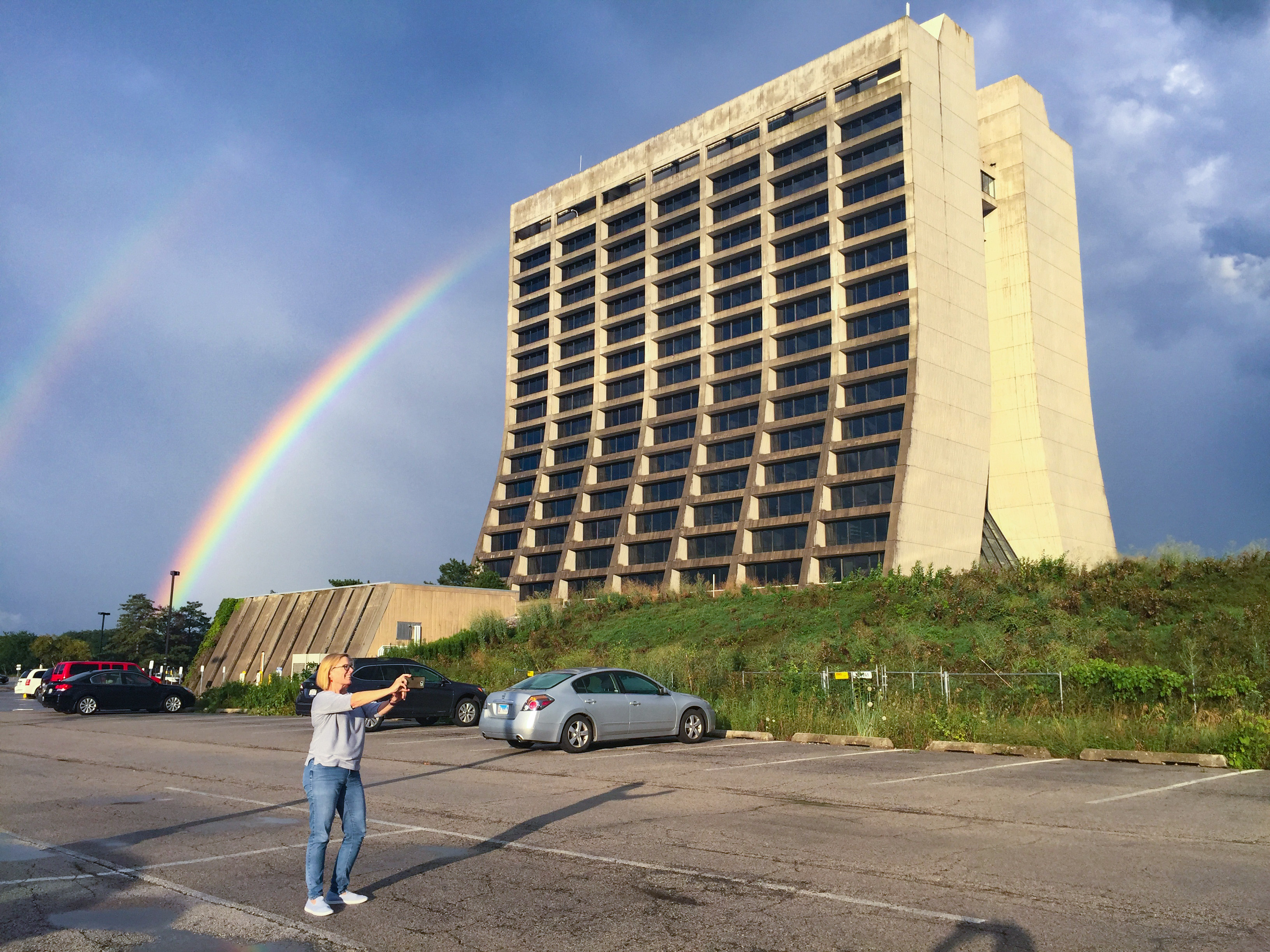 (5/5) Catherine Buck from Procurement pauses to take a selfie a double rainbow and Wilson Hall on Tuesday evening Aug. 13. nature, landscape, sky, rainbow, building, people, Wilson Hall Photo: Reidar Hahn