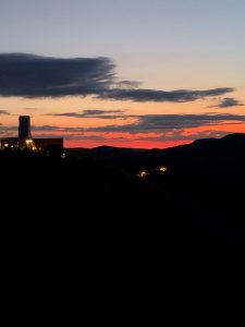 The gorgeous sunrise surrounds the silhouette of the Yates headframe at Sanford Underground Research Facility on a September morning. nature, landscape, LBNF, Long-Baseline Neutrino Facility, Sanford Underground Research Facility, sunrise, sky Photo: Jeffrey Shearer