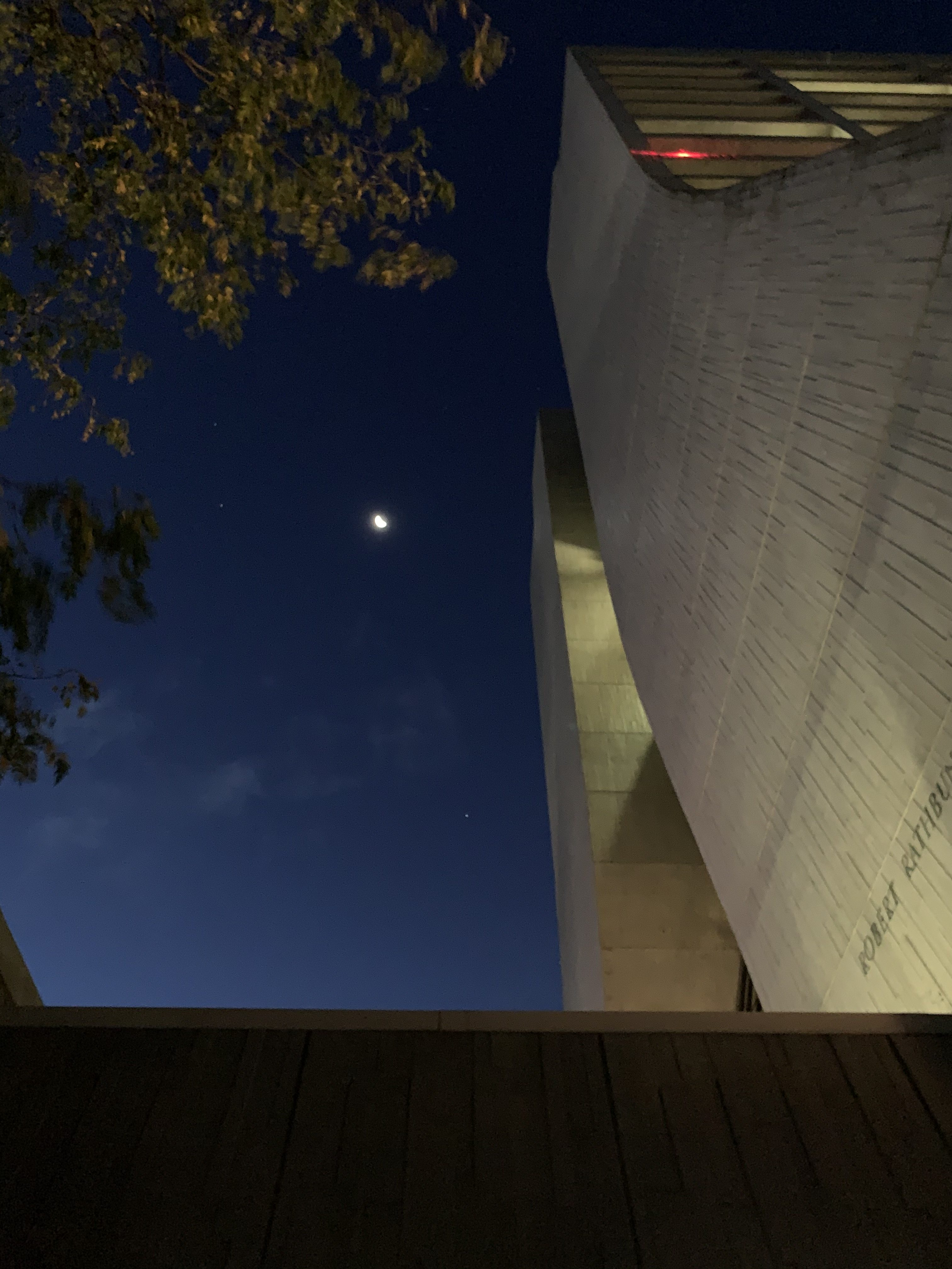 The early morning sky of Sept. 23 peacefully greets you as you enter Wilson Hall. sky, moon, building, Wilson Hall, nature Photo: Josh Juneau