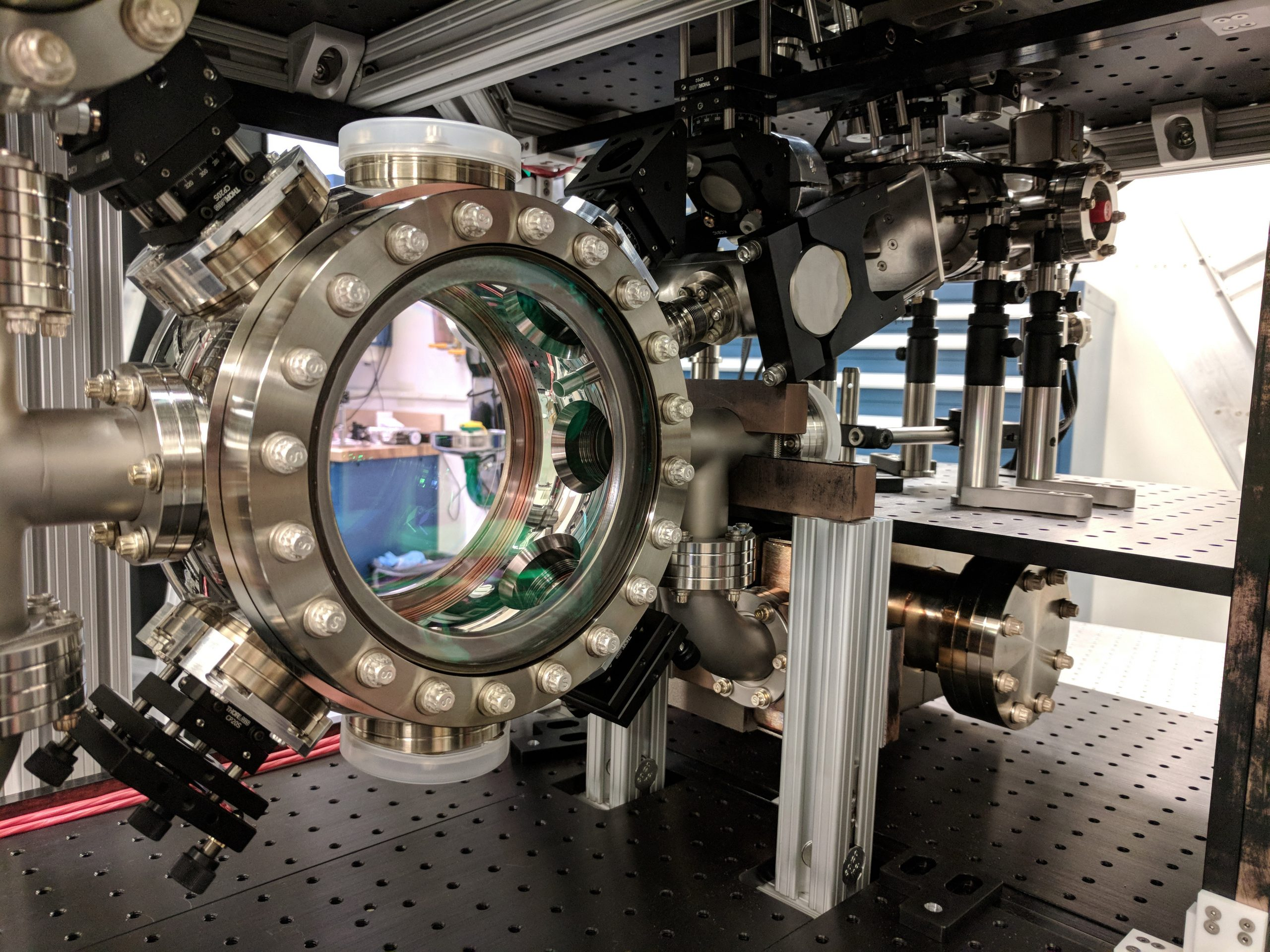 MAGIS-100: Atoms in free fall to probe dark matter, gravity and quantum science
