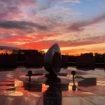 A spectacular orange sky at sunset is seen from the patio outside Wilson Hall atrium. nature, landscape, sky, sunset, sculpture, Mobius Strip Photo: Sudeshna Ganguly