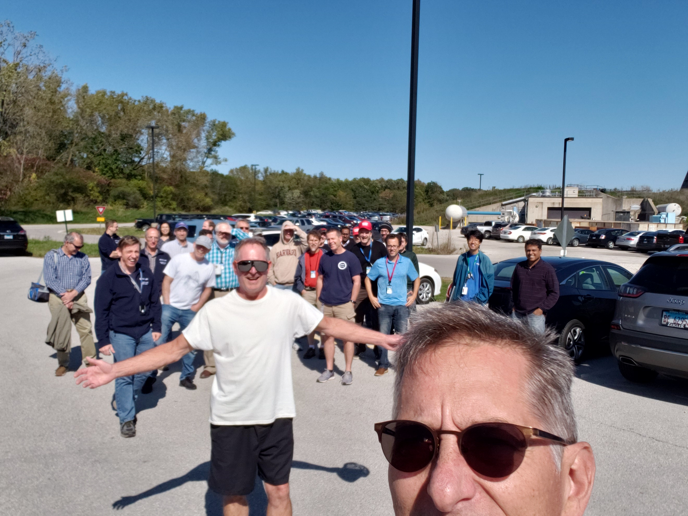 Folks who work in Booster Tower West meet in the emergency assembly area during a fire drill on a beautiful October afternoon. people, lab life Photo: Dave Pushka