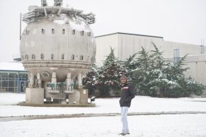 Aloke Das is a Ph.D. student at the National Institute of Science Education and Research in India, currently visiting Fermilab and working under Leonard Spiegel with the outer tracker module system test in the detector test area at SiDet. Aloke will be leaving Fermilab at the end of November, and this morning he woke up to a nice surprise: snow!! He said that this was the first time ever in his life to witness snow fall. He was happy to be able to see it and touch it. I figured he needs the winter experience, so the photographer threw a snowball at him! people, fall, snow, bubble chamber, landscape, nature, winter Photo: Leticia Shaddix