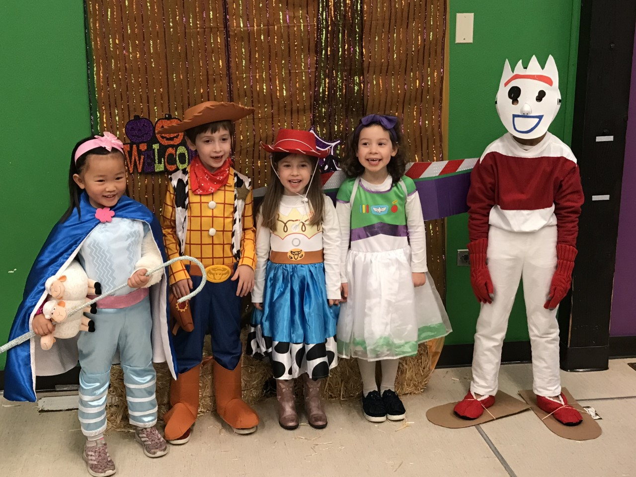"Throwback Thursday: The cast of ""Toy Story 4"" visits the Fermilab Children's Center for the annual Halloween celebration. From left: Bo Peep (Edith Tran), Woody (Luke Soha), Jessie (Rachel Soha), Buzz Lightyear (Hazel Soha), Sporky (Parker Tran). people, lab life Photo: Cancan Tran"