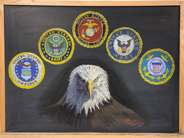 This chalkboard drawing celebrate all of our veterans. You can find it on the third floor of HAB. art, people Drawing: Julie Vander Meulen