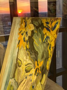 Behind the photographer's self portrait, which is kept in her ninth-floor office, the sun sinks into the horizon. Perhaps at this moment the photographer, like the portrait, is lost in thought. art, sunset, sun Photo: Sudeshna Ganguly