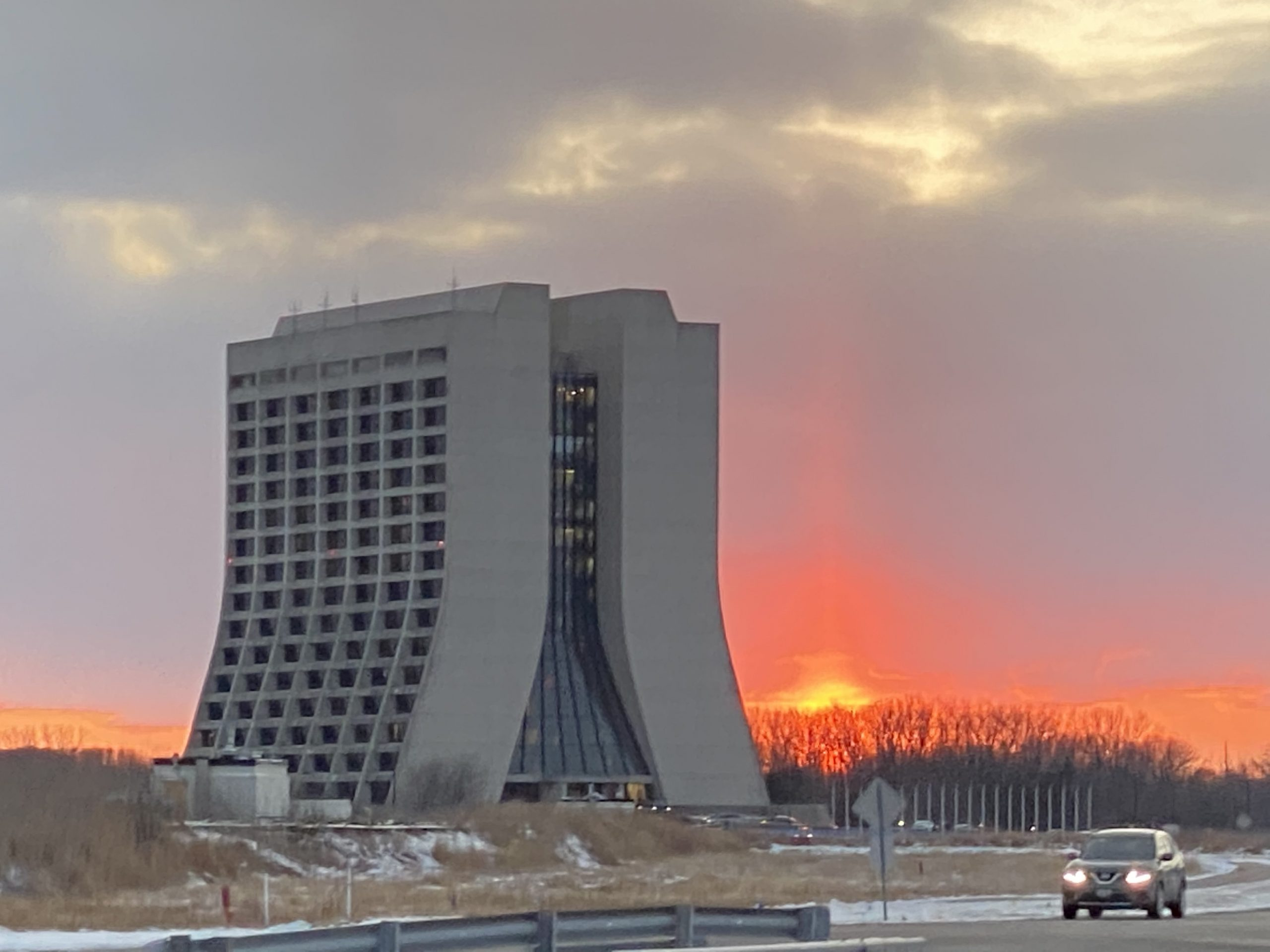 As winter has progressed, the apparent position of the sunset has moved west of Wilson Hall as seen from the Technical Campus here on Feb. 6. nature, landscape, building, Wilson Hall, sun, sunset, cloud, sky Photo: Michael Tartaglia