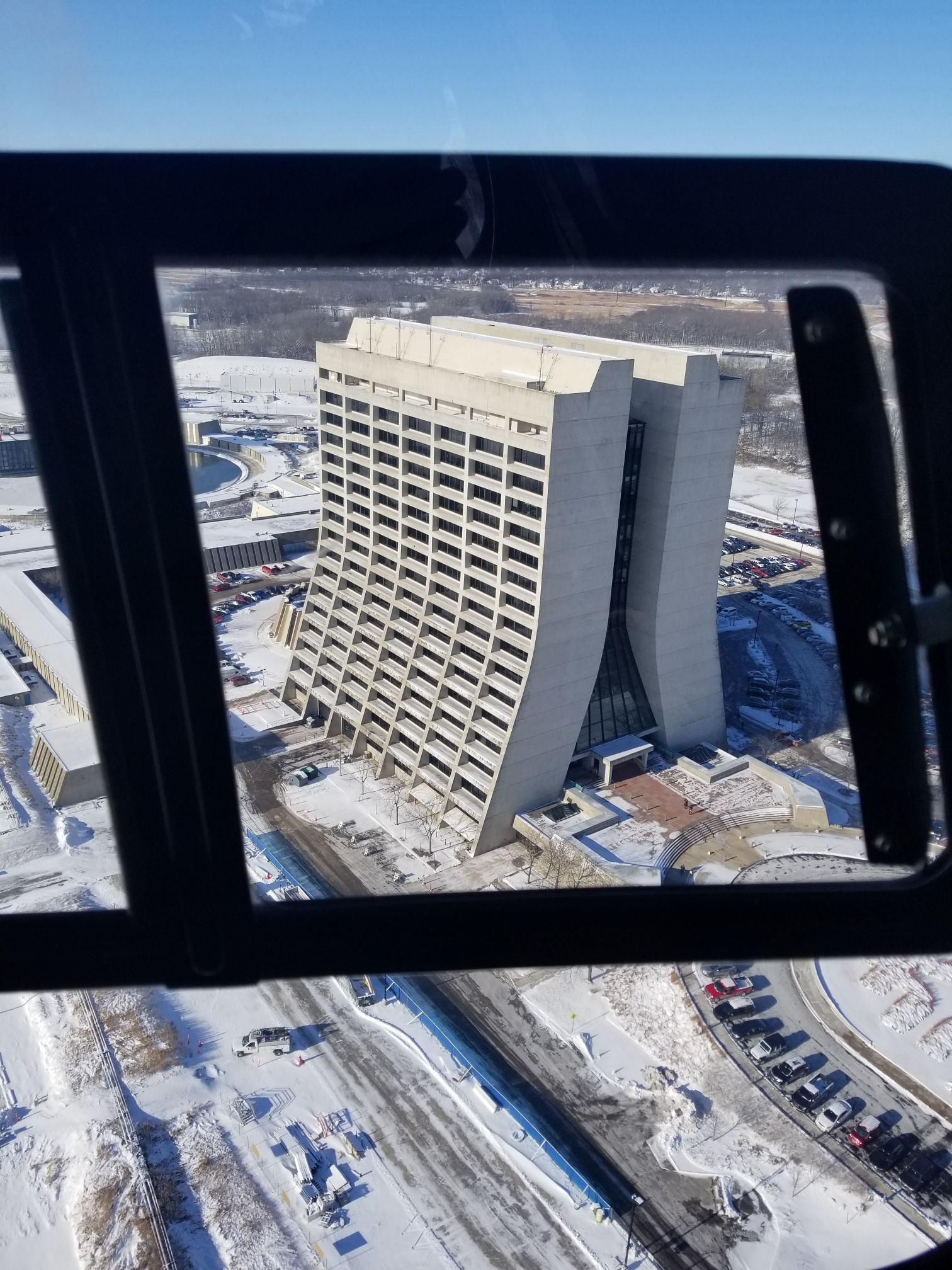 On Friday, Feb. 14, Jon Ylinen and Walter Levernier conduct the annual deer count from a helicopter flying over the Fermilab grounds. The photographer captured this view of Wilson Hall from the air. building, Wilson Hall, winter, snow, aerial Photo: Jon Ylinen