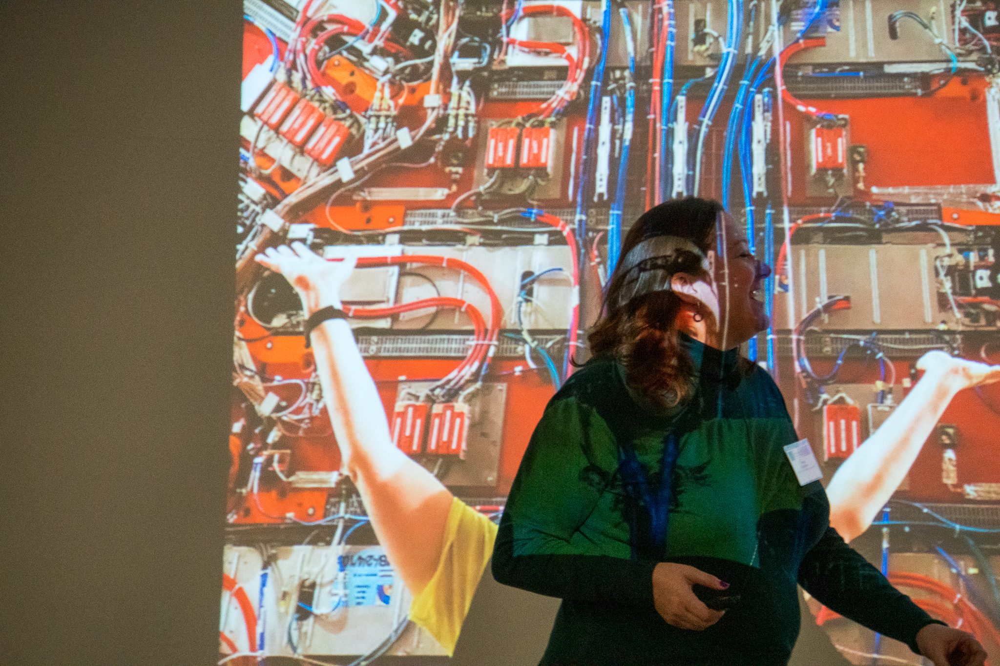 LPC Distinguished Researcher Freya Blekman talks at the CMS Data Analysis School in front of a photo of her at the CMS detector at CERN on Jan. 13. people, CMS, CERN Photo: Marguerite Tonjes