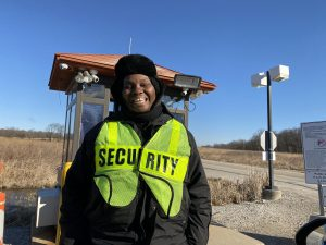 """The guard at the Pine Street gate greets you with a """"Happy Friday"""" after checking your Fermilab ID. The greeting always cheers the photographer. (The photographer was sure to keep her distance while taking the photo.) people Photo: Marguerite Tonjes"""