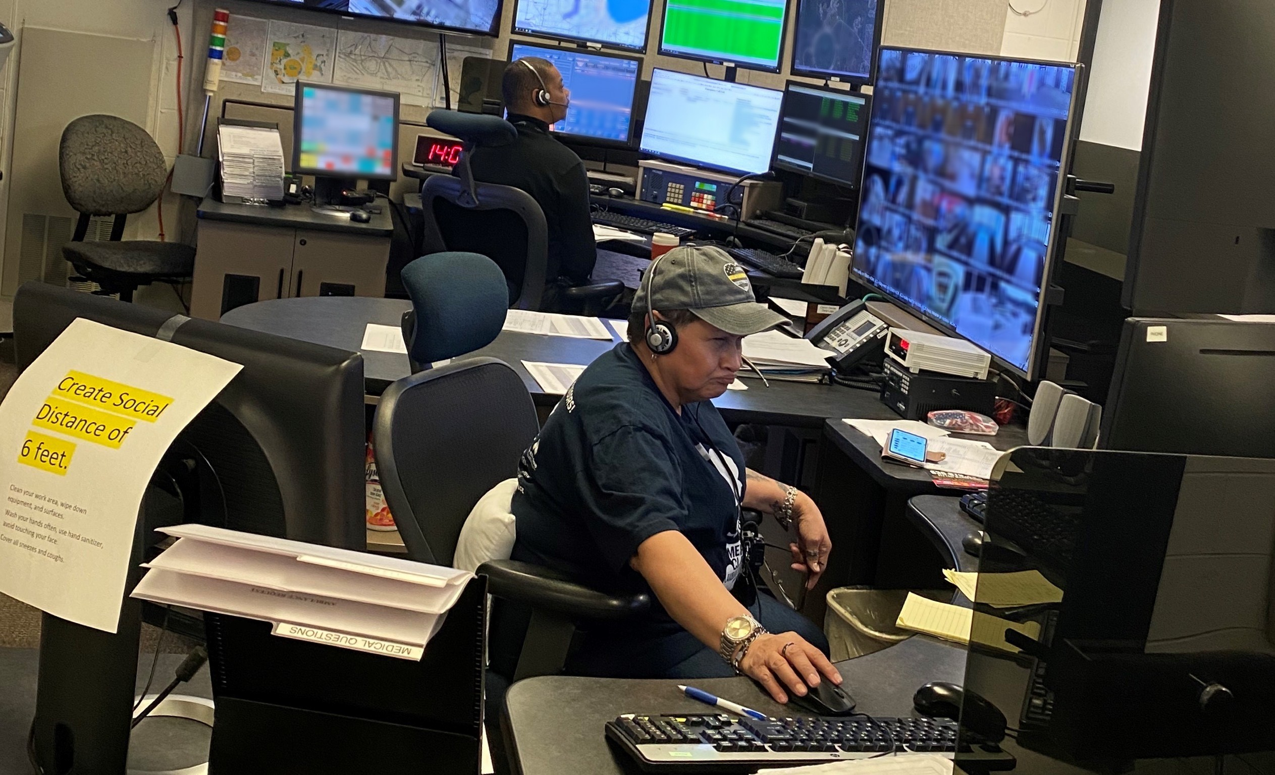 The Emergency Communications Center on the ground floor or Wilson Hall are busy at work, and everyone is practicing social distancing. people Photo: Jessica Jensen
