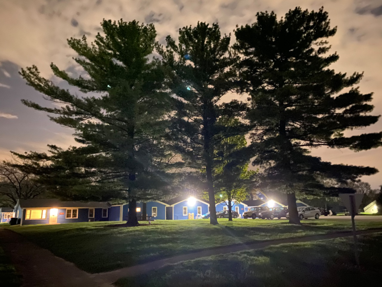 Twinkling lights come from Dorm 5 in the Village at night. landscape, building, plant, tree, night, cloud, night Photo: Zubair Ahmad Dar