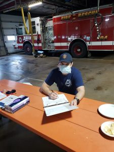 Lieutenant Steve Hernandez of the Fermilab Fire Department reviews information passed to him from previous shifts. Photo: Chuck Kuhn