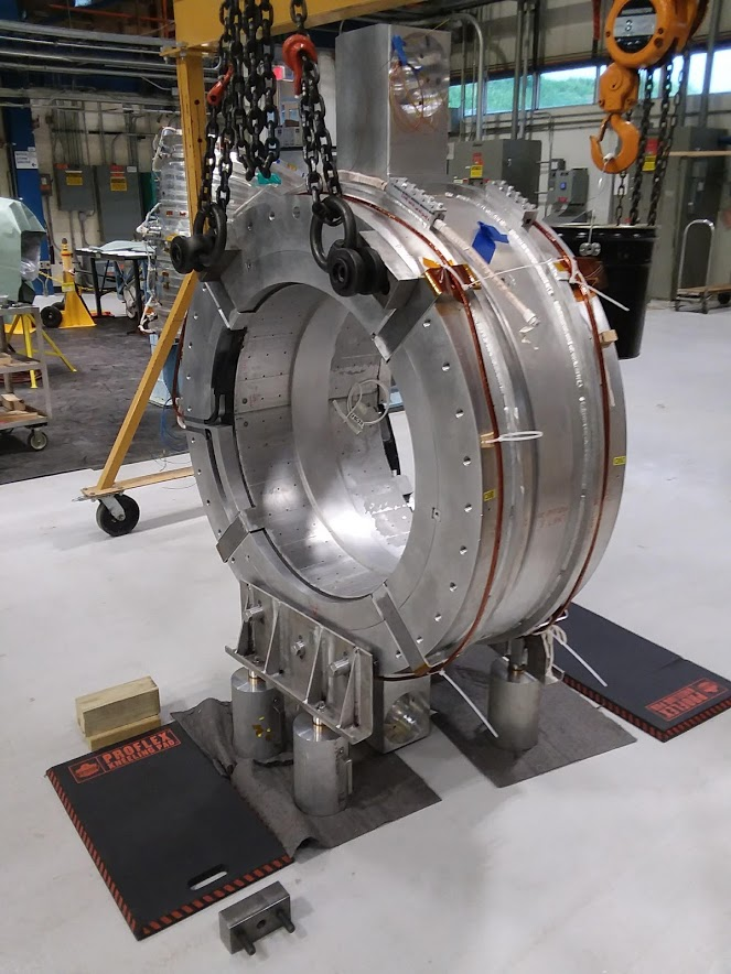 """The Magnet Systems Group is back to work in HAB, building the Mu2e transport solenoid magnets. We performed what we believe is the first """"critical lift"""" under the new FESHM 10200 Lift Plans chapter on Wednesday, June 3. This is test unit TSUN08 in its warm testing position. Mu2e, operations, magnet, technology Photo: Jeff Brandt"""