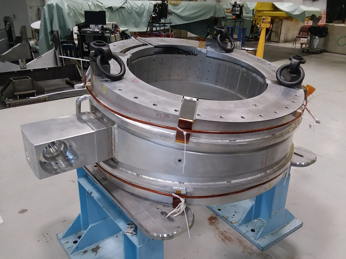 Our group used two cranes to rotate test unit TSUN08 from the bore-tube-horizontal warm testing position (pictured above) to the bore-tube-vertical cold testing position (seen here). Mu2e, technology, magnet, operations Photo: Jeff Brandt