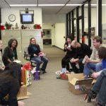 Flashback Friday: A 2013 winter holiday. After lunch, people enjoyed a white elephant gift exchange - always interesting! people, holiday Photo: Leticia Shaddix