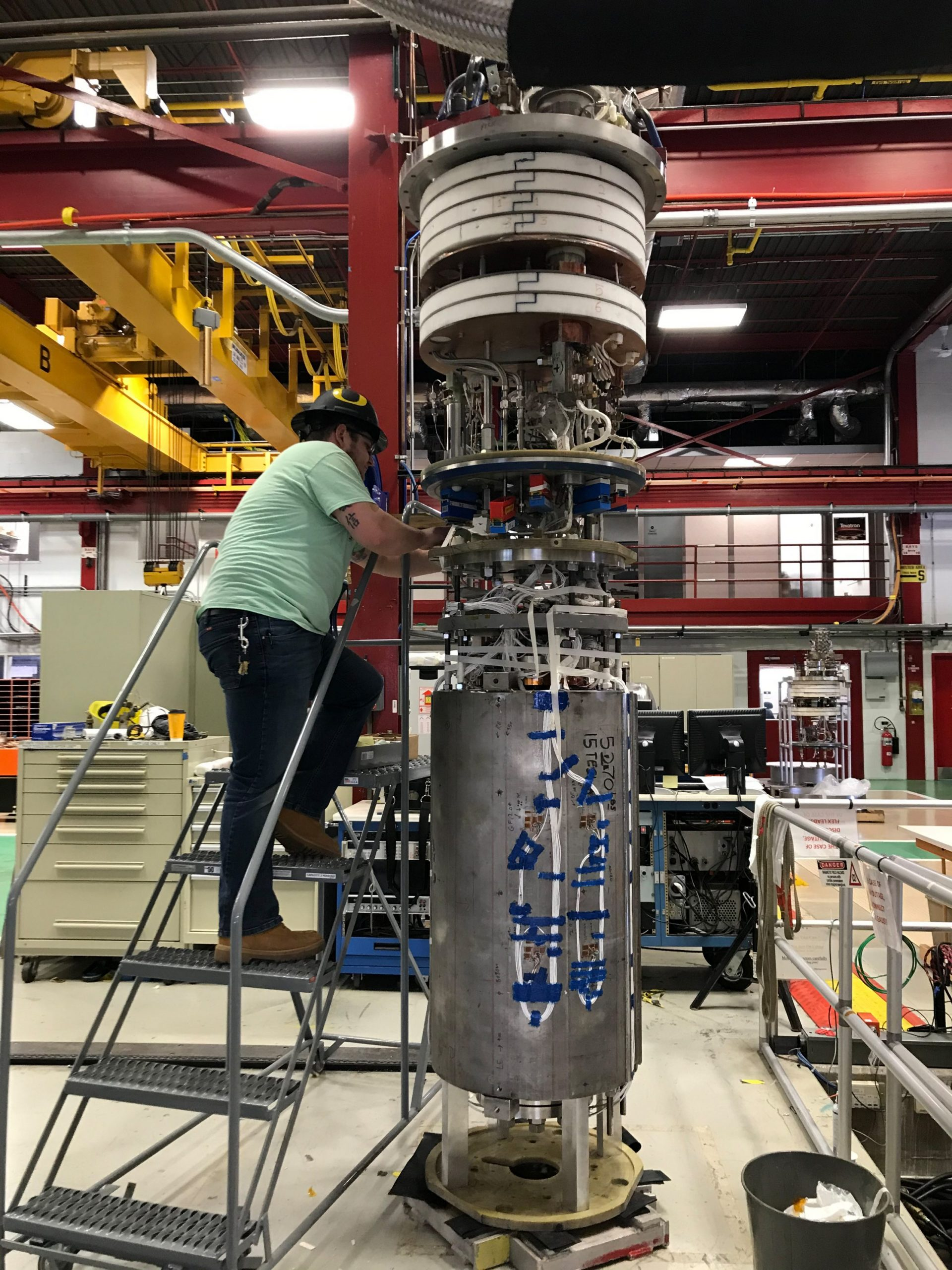 A member of the Fermilab magnet team prepares the demonstrator accelerator magnet for testing in March 2020. These tests are an important step toward meeting the requirements of the future hadron collider that is under discussion in the particle physics community.