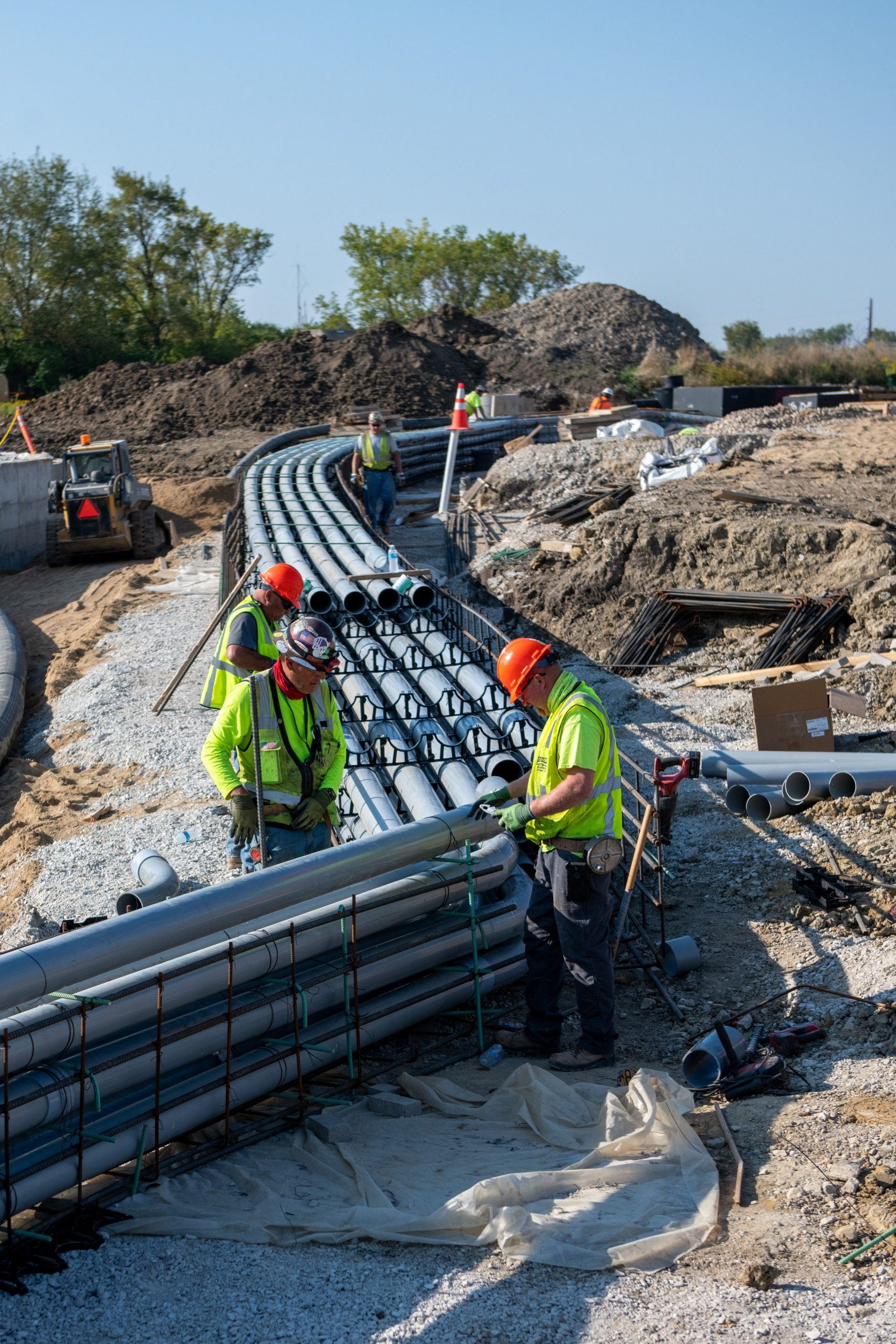 These conduits will carry rerouted Main Injector and future LBNF electrical and communication cables. They have since been encased in concrete.