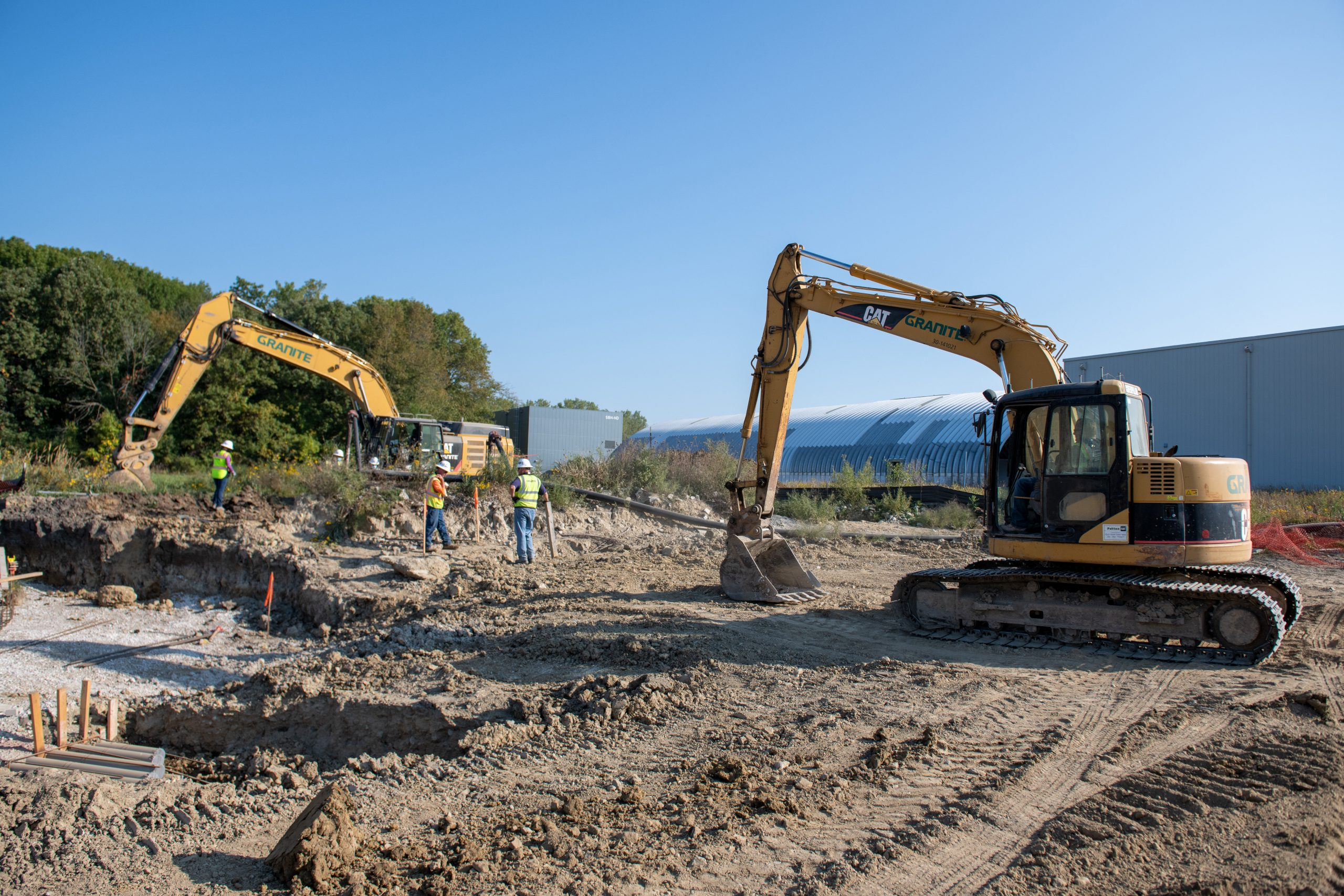 Workers prepare the site for the installation of electrical lines and a sump. Beneath the surface is a new culvert.