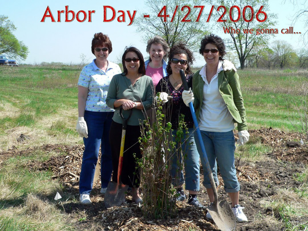 Fermilab employees plant trees on April 27, 2006. From left: Karen Carew, Colleen Yoshikawa, Barb Kristen, Ellie Arroyo-Weerts, Sue Schultz. All are now retired.people, lab life, ecology, environment Photo: Leticia Shaddix