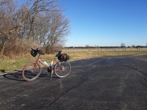 On a sunny December day, a commuting bicycle sits outside IB3 by the bison pasture. everyday objects, landscape, prairie, campus Photo: Luciano Elementi