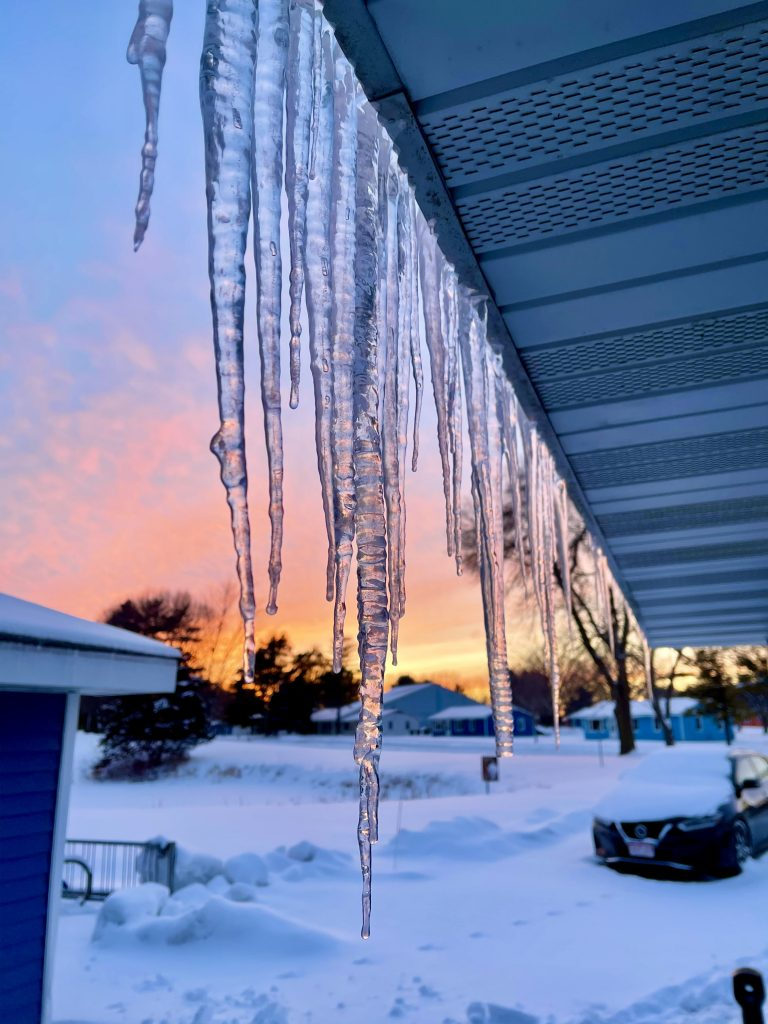 Icicles hang from Dorm 5 in the Village in front of a vibrant winter sunset. campus, ice, winter, sunset, snow, Village Photo: Zubair Dar