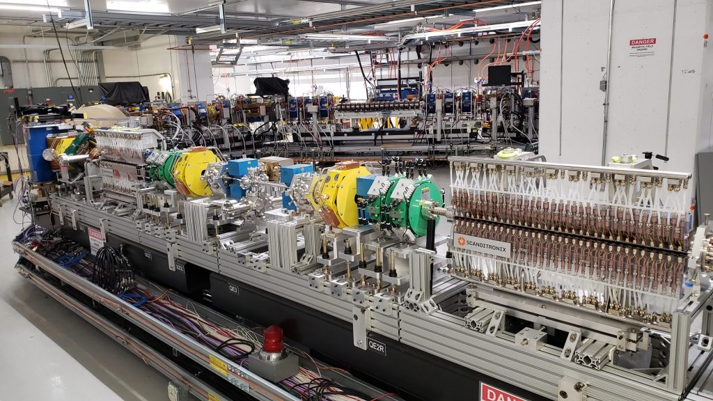 The two components with Scanditronix logos pictured here are the heart of IOTA's optical stochastic cooling experiment. The pickup (left) measures the spread of the particle beam, and then the kicker (right) corrects the stray motion of the particles. Photo: Jonathan Jarvis, Fermilab