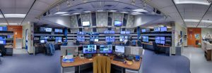Particle accelerator operators track all the individual accelerator subsystems at once. The diagnostic signals pinging from individual subsystems form a vast informational web, and the data appear on screens that cover the walls of Fermilab's Main Control Room, command central for the accelerator complex, pictured here. A machine learning program will not only track signals, but also quickly determine what specific system requires an operator's attention. Photo: Reidar Hahn, Fermilab