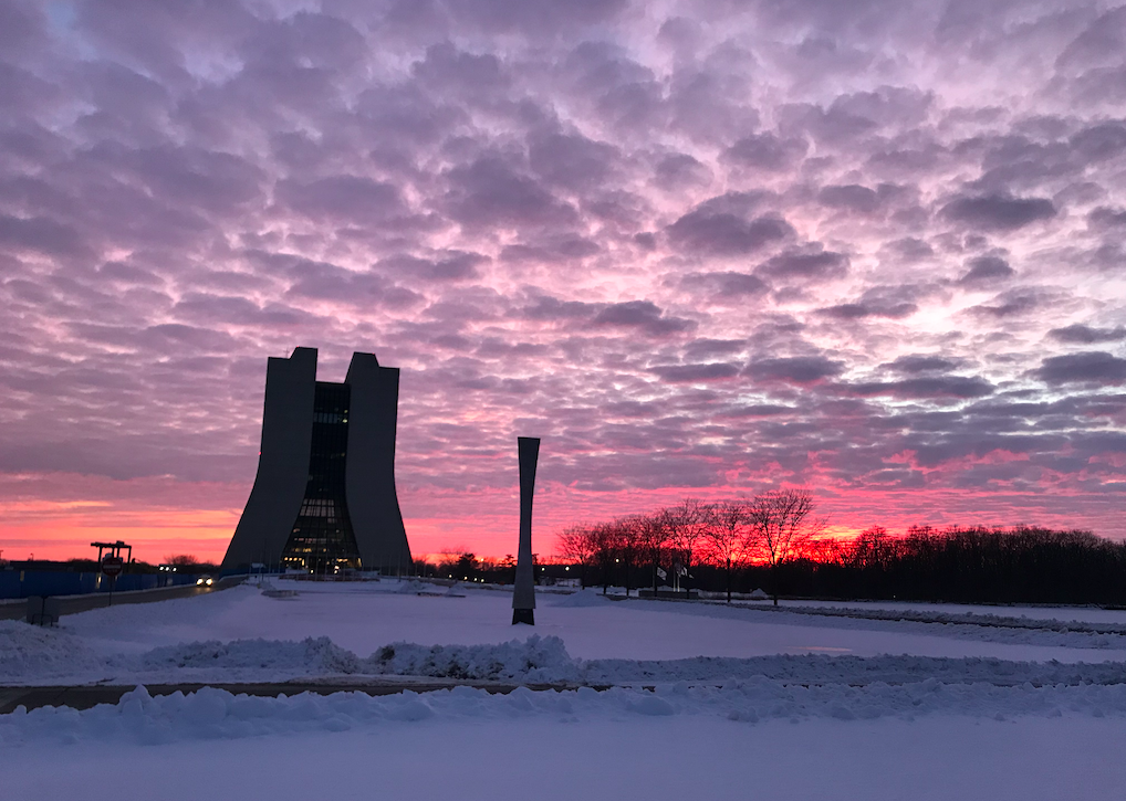 On Feb. 3, 2021, Wilson Hall stands amidst purple clouds and coral sky at sunset. campus, Wilson Hall, snow, sunset, sky, cloud Photo: Donatella Torretta