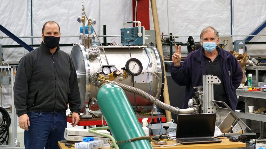 On Feb. 17, 2021, in Lab B at SiDet, Fermilab scientist Juan Estrada and technical specialist Andrew Lathrop stand on either side of the outer shell for the prototype vessel that they have developed for the operation of charge-coupled devices in a liquid nitrogen bath. people, SiDet, Lab B Photo: Leticia Shaddix