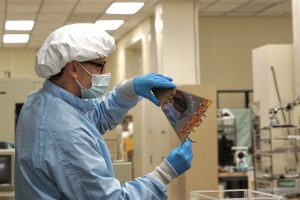 """In February 2021, after some inspection, senior operations specialist Humberto """"Bert"""" Gonzalez holds up a module called the STAR detector — Solenoidal Tracker At Rhic — for Forward Silicon Tracker, or FST, for Brookhaven National Laboratory. Brookhaven National Laboratory, detector, people Photo: Leticia Shaddix"""