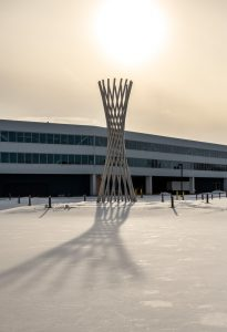 On Jan. 27, 2021, the sun glares down on Tractricious through an overcast sky long enough for the sculpture to cast its impressive shadow on the snow. snow, winter, campus, Tractricious, sun, building Photo: Ryan Postel