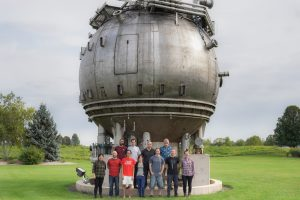 Members of the Fermilab CCD group pose in front of the bubble chamber. Juan Estrada is third from the left in the back row. people, bubble chamber, campus Photo: Leticia Shaddix
