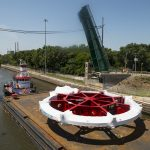 On July 19, 2013, the Muon g-2 magnet ring was moving up the Illinois River on its five-week journey from Brookhaven National Laboratory (Long Island, New York) to Fermilab. Scientists will announce the first results from the Muon g-2 experiments at 10 a.m. CDT on April 7, 2021. Muon G-2, Brookhaven National Laboratory Photo: Reidar Hahn, Fermilab