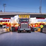 On July 23, 2013, the 50-foot-wide Muon g-2 magnet ring was on its way to Fermilab by truck. Scientists will announce the first results from the Muon g-2 experiments at 10 a.m. CDT on April 7, 2021. Muon g-2, magnet Photo: Reidar Hahn, Fermilab