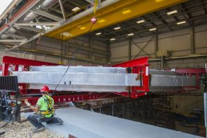 On July 30, 2014, a rigging crew moved the Muon g-2 magnet ring into the new MC-1 building on the Fermilab site. Muon g-2, people, MC-1, magnet Photo: Cindy Arnold, Fermilab