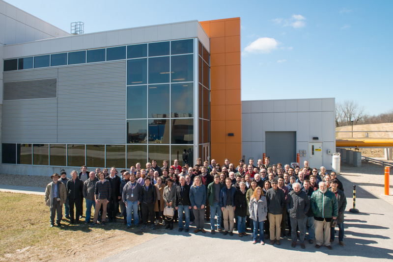 On March 22, 2017, members of the Muon g-2 collaboration gathered at Fermilab, in front of the MC-1 building, which houses their experiment. Muon g-2, people, MC-1, building Photo: Al Johnson, Fermilab