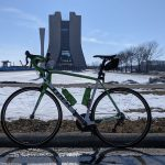On Feb. 27, 2021, an afternoon bike stop on a sunny day takes place in front of Wilson Hall as the snow melts. sun, Wilson Hall, campus, bicycle, snow, construction, winter Photo: Dan Bollinger