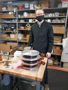In March 2021, Noah Curfman is assembling the solenoid, newly built by Bill Robotham's group, for Laboratory Directed Research and Development: Improving magnetic materials for rapid-cycling synchotron cavity tuners. people, LDRD, accelerator technology, cavity Photo: Robyn Madrak Plant