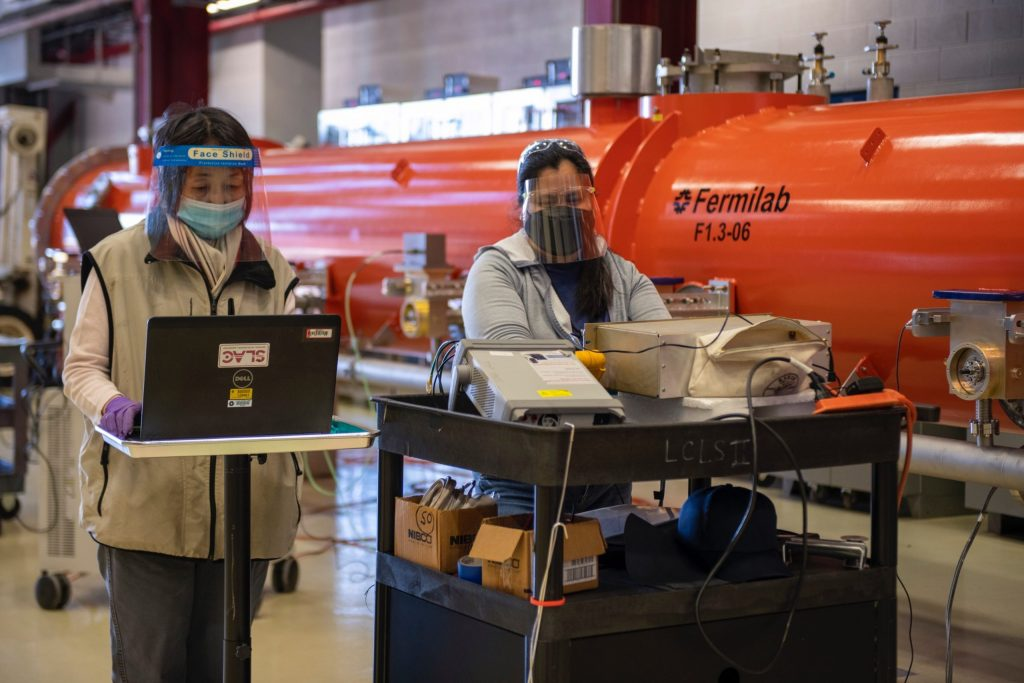 Fermilab technicians prepare the cryomodule for transport by performing final checks on instrumentation. Photo: Ryan Postel, Fermilab