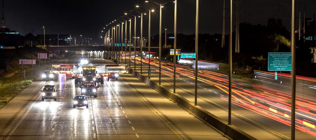 The night the Muon g-2 magnet ring arrived on site in July 2013, it traveled westbound on I-88 from I-355.The picture here was taken from the Mill Street overpass in Naperville.The precision nature of the ring required that it be shipped in one whole piece that spanned four lanes of the interstate; the truck speed could not exceed 25 miles per hour. Muon g-2, magnet, road, Photo: Marty Murphy