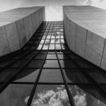 On June 12, 1974, the sky reflects on a brand-new Central Laboratory Building, what is now Wilson Hall. Construction for the building began in 1971 and was completed in 1974. Wilson Hall, campus Credit: Fermilab