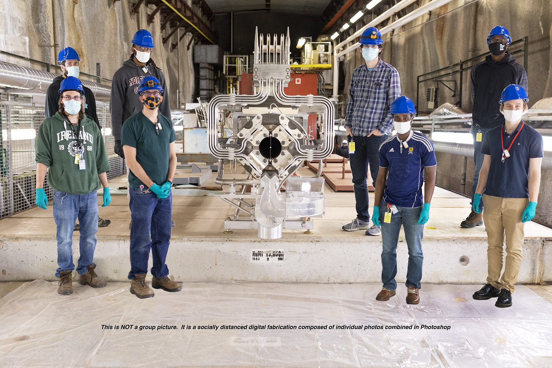 """Eight people in masks that cover the lower halves of their faces stand in blue hard hats in two rows of four beside a silver piece of equipment in a construction-looking area of wood-looking platform and clear plastic tarp. Text along the photo says """"This is NOT a group picture. It is a socially-distanced digital fabrication composed of individual photos combined in Photoshop."""""""