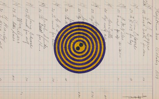 A piece of ledger paper runs perpendicularly with an ornate, old-fashioned script font, with names and notes. At the top (on the right-hand side of the illustration), the date is 1889. A large button of yellow and blue thin concentric circles with two button holes in the middle overlays the text in the center of paper.