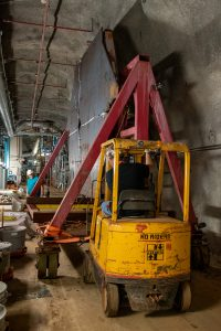 Machinery and a worker during decommissioning.