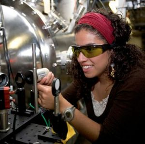 A woman works on equipment